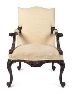 A George III Style Carved Mahogany Library Armchair Height 43 1/2 x width 30 inches.