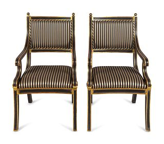 A Set of Eight Regency Style Parcel-Gilt and Black-Painted Armchairs Height overall 40 x width of seat 23 inches.