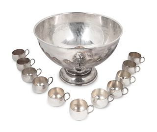 An American Silverplate Large Punchbowl and Twelve Cups Height of bowl 11 x diameter 16 1/4 inches.