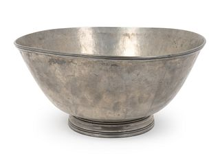An American Pewter Punchbowl and Ladle Height of bowl 8 x diameter 16 1/2 inches; length of ladle 11 1/2 inches.