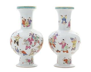 A Pair of Famille Rose Porcelain Vases Height of pair 8 7/8 inches.