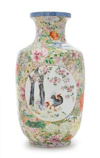 """A Famille Rose """"Millefleurs"""" Porcelain Vase Height 12 1/2 inches."""