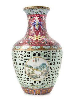 * A Famille Rose Porcelain Vase POSSIBLY EARLY 20TH CENTURY Height 16 inches.