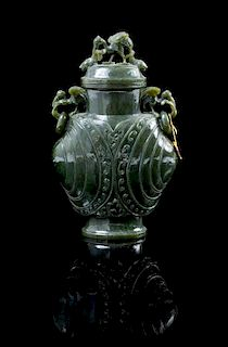 A Carved Spinach Jade Vase Height 7 1/4 inches.