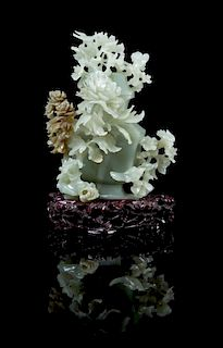 A Carved Jade Vase and Cover 20TH CENTURY Height of jade 7 5/8 inches.