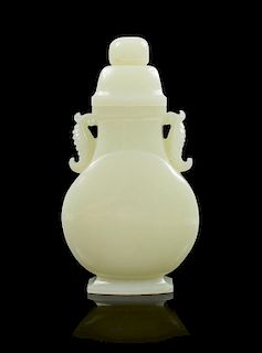 A Celadon Jade Vase and Cover Height 7 1/4 inches.
