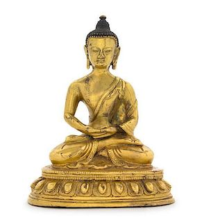 A Gilt Bronze Figure of Buddha Height 5 7/8 inches.
