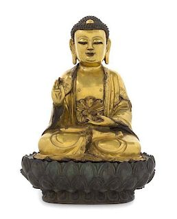 A Gilt Bronze Figure of Buddha Height overall 14 inches.