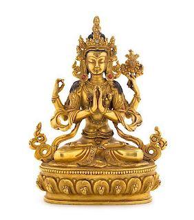 A Sino-Tibetan Gilt Bronze Figure of a Bodhisattva Height 6 1/2 inches.