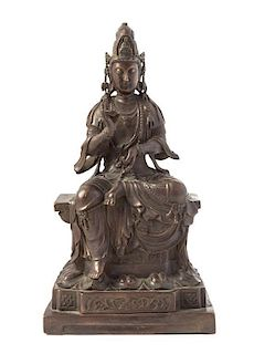 * A Bronze Figure of Guanyin Height 14 1/4 inches.