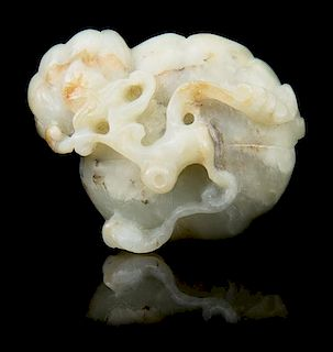 * A Carved Jade Toggle Length 2 1/8 inches.