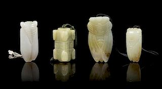 * Four Carved Jade Pendants Length of longest 2 3/4 inches.