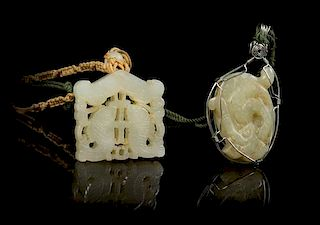 * Two Carved Jade Pendants Length of first 1 7/8 inches.
