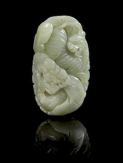 * A Carved Jade Toggle Length 3 1/8 inches.