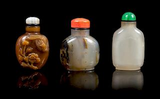 A Group of Three Agate Snuff Bottles POSSIBLY 19TH CENTURY Height of tallest 2 7/8 inches.