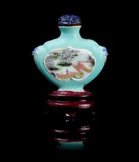 A Famille Rose Porcelain Snuff Bottle Height overall 2 5/8 inches.