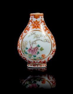 A Famille Rose, Iron Red and Gilt Decorated Porcelain Snuff Bottle Height 2 1/2 inches.