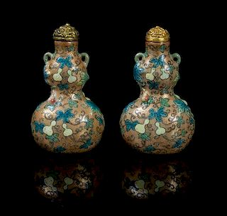* A Pair of Polychrome and Gilt Enameled Porcelain Snuff Bottles LIKELY 18TH/19TH CENTURY Height 2 1/2 inches.