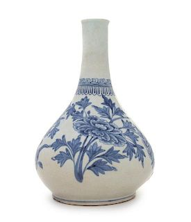 * A Korean Blue and White Porcelain Bottle Vase Height 9 3/4 inches.