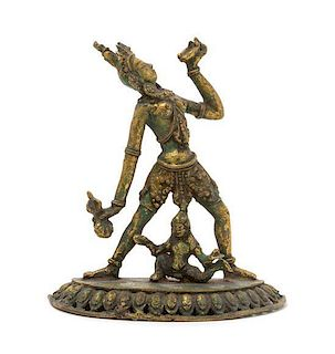 * A Gilt Bronze Figure of a Bodhisattva Height 5 inches.