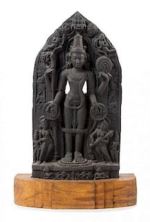 An Indian Red Sandstone Stele of Vishnu Height overall 30 inches.