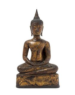 * A Thai Bronze Figure of Buddha LIKELY AYUTTHAYA PERIOD Height 11 1/2 inches.