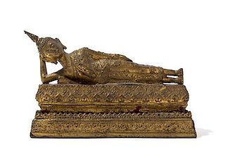 A Thai Gilt Bronze Figure of a Reclining Buddha Height 6 1/4 inches.