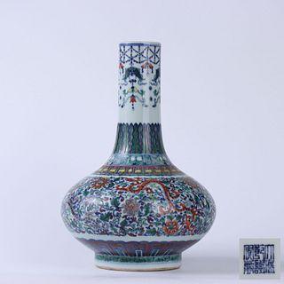 A Chinese Doucai  'Chi Dragon' Floral Porcelain Bottle Vase