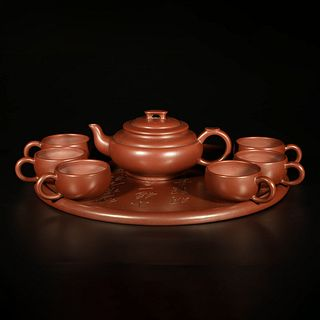 A Set Of Eight Chinese Purple-Clay Pieces