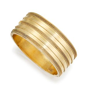 AN ETRUSCAN REVIVAL CUFF/BANGLE, the broad hinged cuff/bang