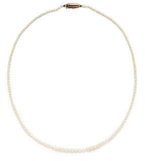 A CERTIFIED NATURAL SALTWATER PEARL NECKLACE, the graduated