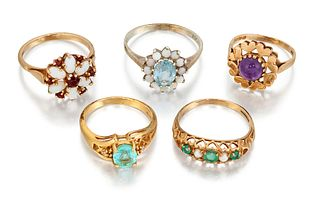FIVE GEMSET RINGS, to include an 18ct aquamarine ring with