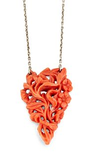 A CARVED CORAL NECKLACE, the triangular coral pendant carve