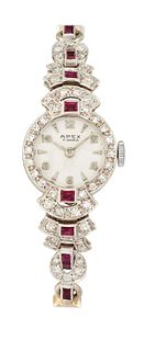 A 9CT RUBY AND DIAMOND COCKTAIL WATCH, the round white dial
