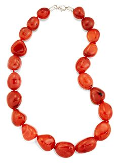 A CARNELIAN BEAD NECKLACE, the off-oval carnelian beads, be