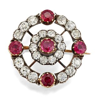 A 19TH CENTURY RUBY AND DIAMOND BROOCH, the round central r