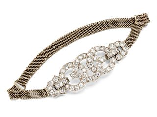 AN ART DECO DIAMOND BRACELET, set with three overlapping di