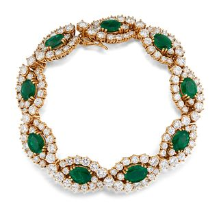 AN 18CT EMERALD AND DIAMOND BRACELET, the oval cut emeralds