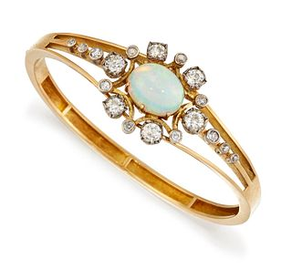 AN 18CT OPAL AND DIAMOND BANGLE, the oval opal cabochon, ap