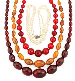 THREE FAUX AMBER NECKLACES AND A CULTURED PEARL NECKLACE, t