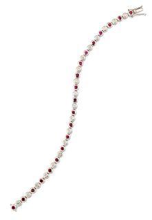 A RUBY AND DIAMOND BRACELET, the alternating round rubies a