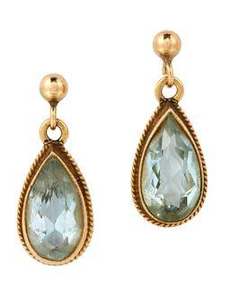 A PAIR OF AQUAMARINE EARRINGS, the pear shaped aquamarine d