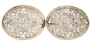 AN OVAL FILIGREE SILVER BUCKLE, the oval buckles each with