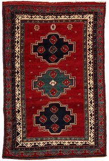 A FINE AND BOLD ANTIQUE BORDJALOU KAZAK RUG