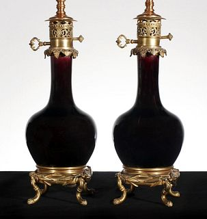 A PAIR FRENCH 19TH C. ORMOLU AND PORCELAIN FLUID LAMPS