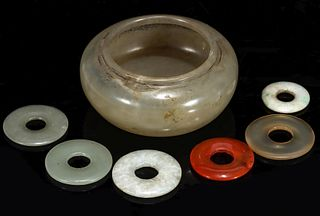 A 19TH CENTURY CHINESE JADE BRUSH WASHER AND PENDANTS
