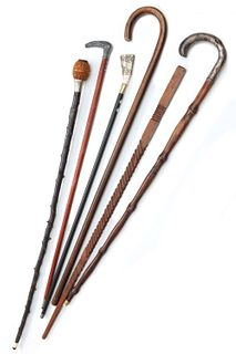 A COLLECTION OF CANES, WALKING STICKS AND SIMILAR ITEMS