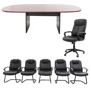 Sala de juntas. Siglo XX. Elaborados en material sintético, metal y MDF enchapado. Consta de: Mesa de juntas y 6 sillones ejecutivos.