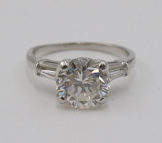 Modern Round Brilliant Diamond and Platinum Ring