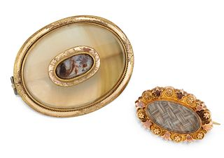 A 9CT HAIRWORK BROOCH AND A CHALCEDONY MEMORIAL BROOCH, the
